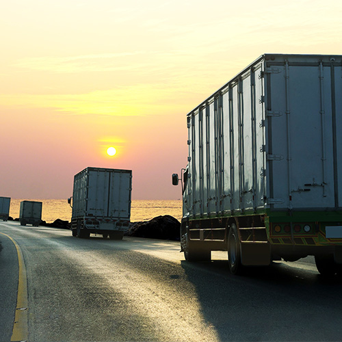 Sin título-2_0001_truck-highway-road-with-container-logistic-industrial-transport-with-sunrise-sky